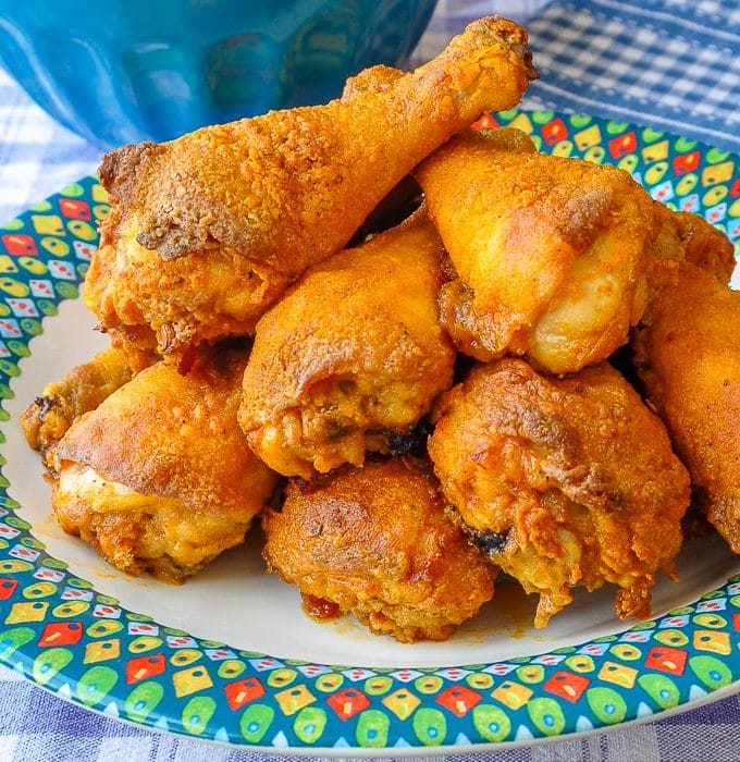 Barbecue Spice Oven Fried Chicken close up photo of cooked chicken pieces on a multicolored plate