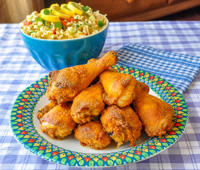 Barbecue Spice Oven Fried Chicken with pasta salad in the background