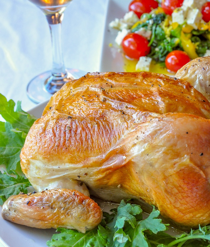 Asian Spice Brined Roast Chicken on a bed of greens