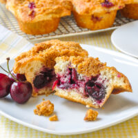 Cherry Muffins with Graham Crumb Streusel cut in half to show whole cherries in the centre
