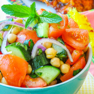 Close up photo of Tomato Cucumber Salad with Chickpeas & Mint