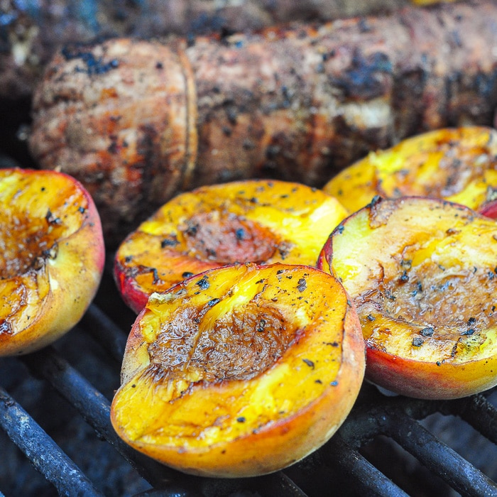 Grilled Balsamic Peach Pork Tenderloin close up photo of peaches on the grill