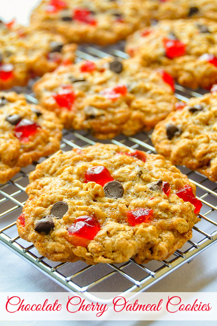 Chocolate Cherry Oatmeal Cookies cooling on a wire rack with title text added for Pinterest