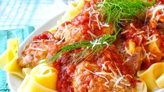 Tomato Fennel Braised Chicken Thighs on a white platter