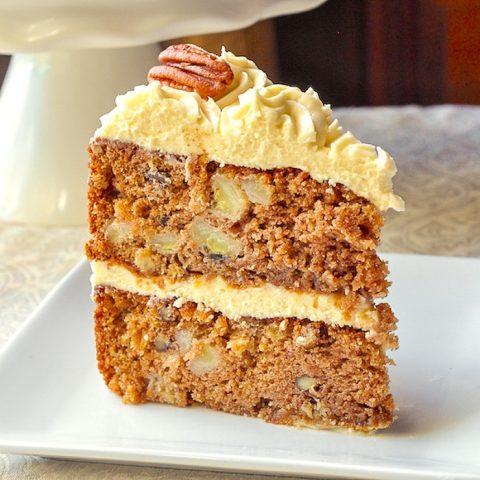 Hummingbird Cake close up photo of single slice on white plate