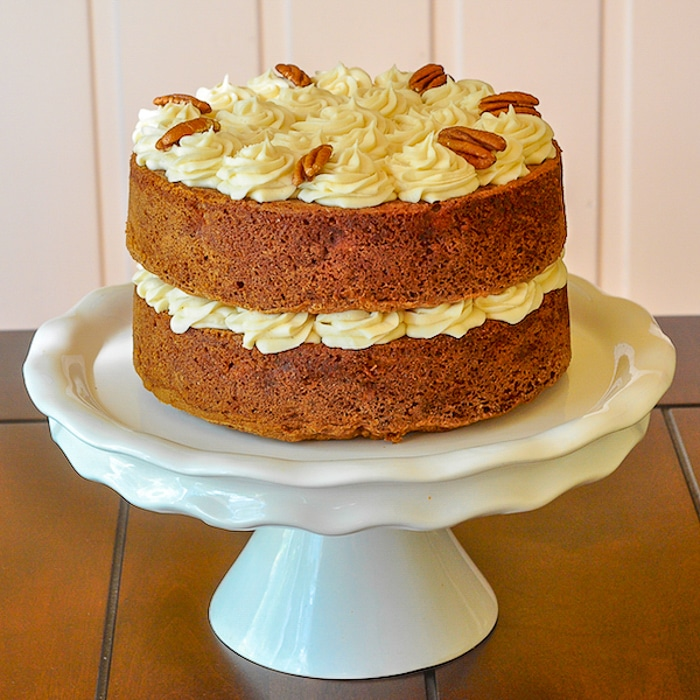 Hummingbird Cake photo of uncut cake on white pedestal stand