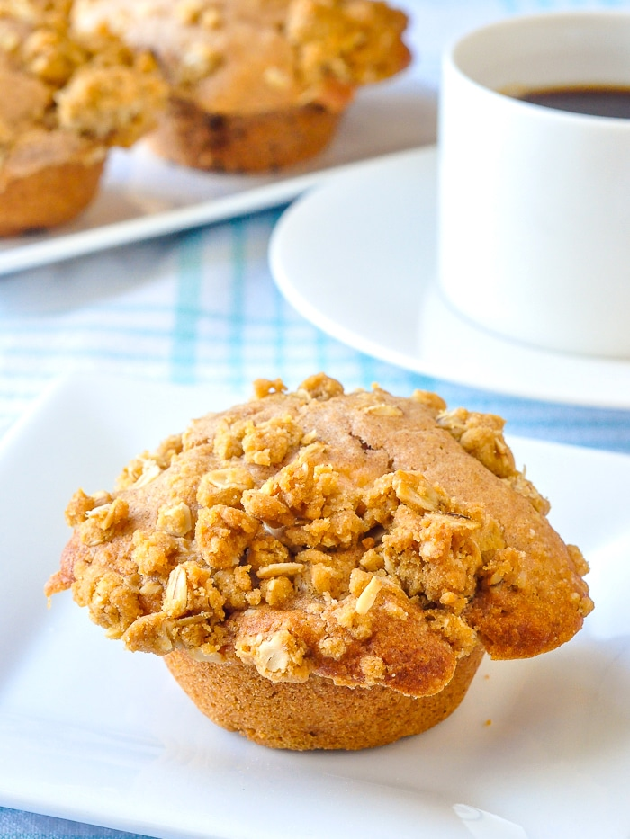 Apple Crumble Muffins shown with black coffee