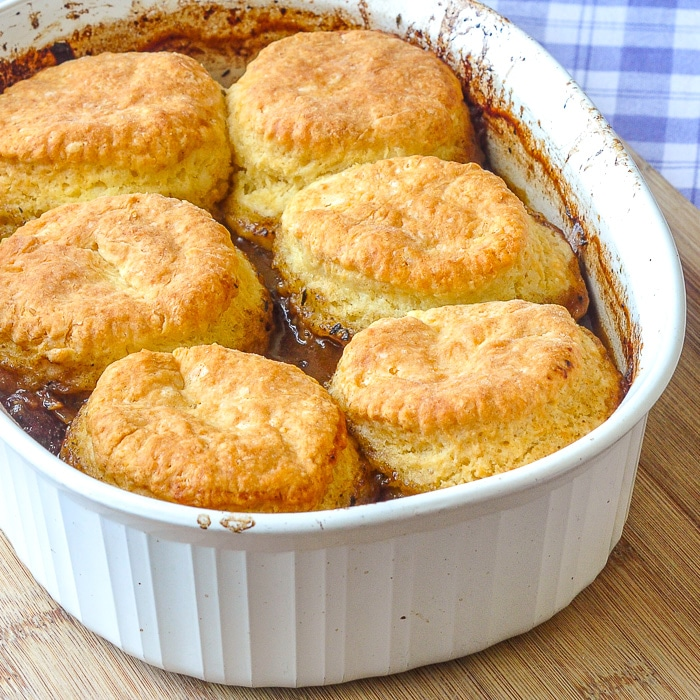 Braised Beef Pot Pie with Biscuit Topping in a casserole dish fresh from the oven