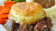 Braised Beef Pot Pie with Biscuit Topping - an amazing, slow cooked, comfort food Sunday dinner.