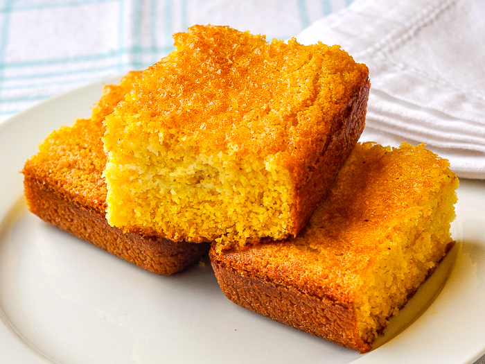 Photo of the best easy cornbread recipe photo of e servings stacked on a white plate