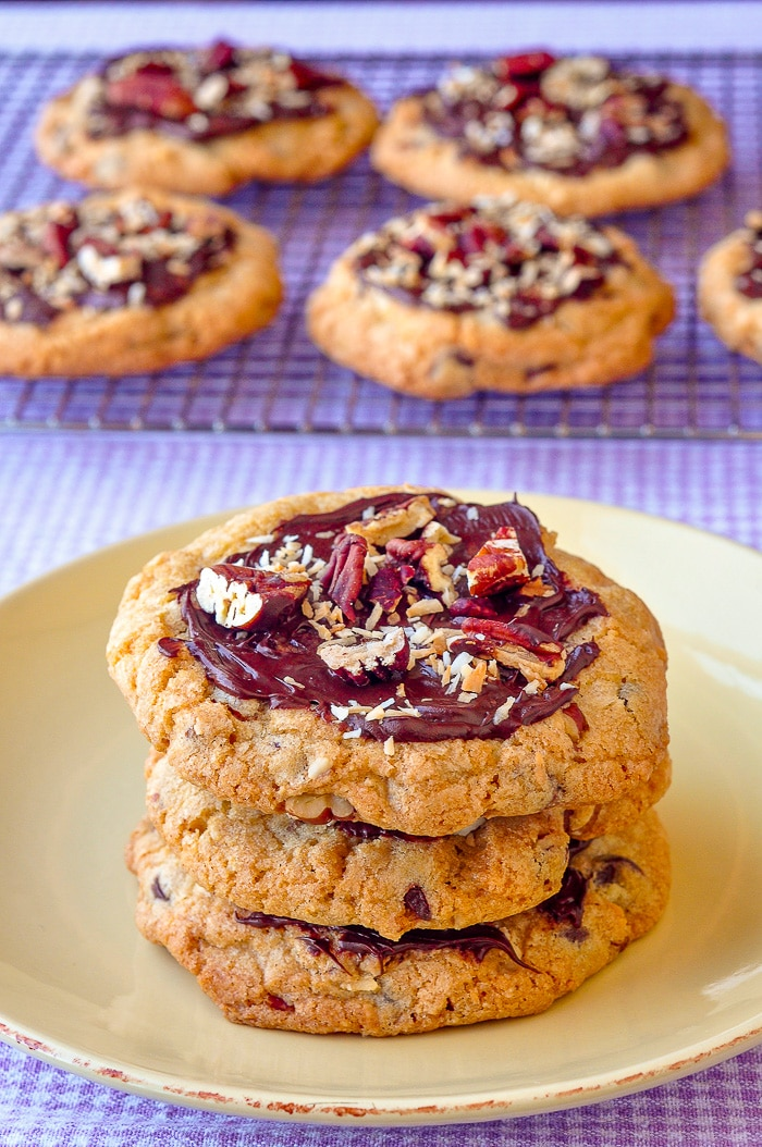 Coconut Pecan Chocolate Chip Cookies stacked on yellow plate