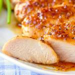 Honey Dijon Garlic Chicken Breasts close up of sliced chicken breast.