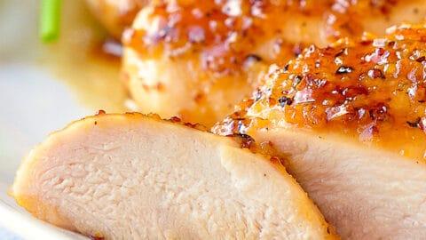 Honey Dijon Garlic Chicken Breasts close up of sliced chicken breast.