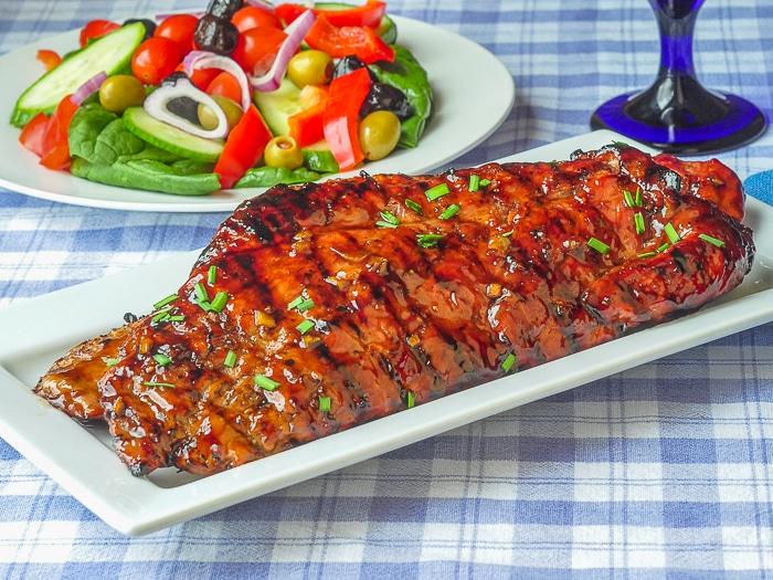 Low Fat Honey Garlic Boneless Ribs uncut slabs of ribs on white serving platter