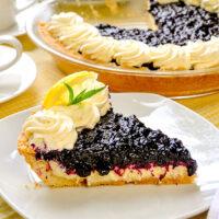 Close up photo of one slice of Lemon Blueberry Cheesecake Pie