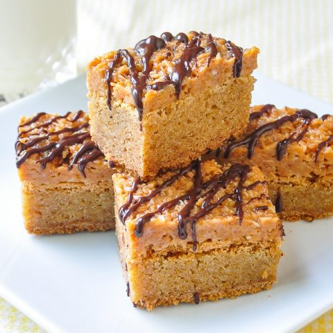 Photo of Samoa Blondies stacked on a square white plate