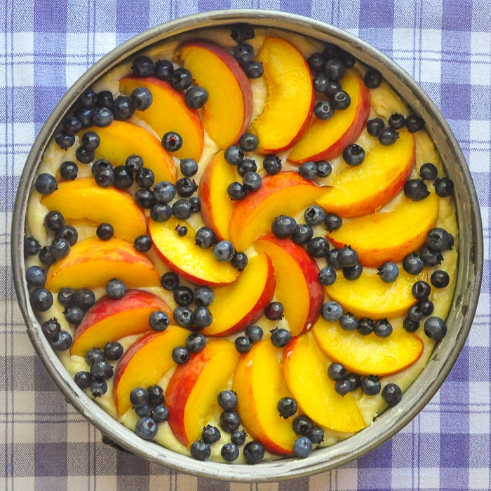 Blueberry Peach Sour Cream Cake ready for the oven