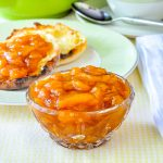 Easy Roasted Peach Jam shown in a small glas serving dish.