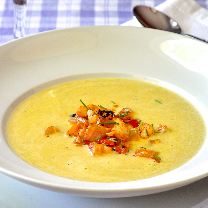 Summer Corn Soup with Grilled Shrimp Sriracha Salsa in a white bowl