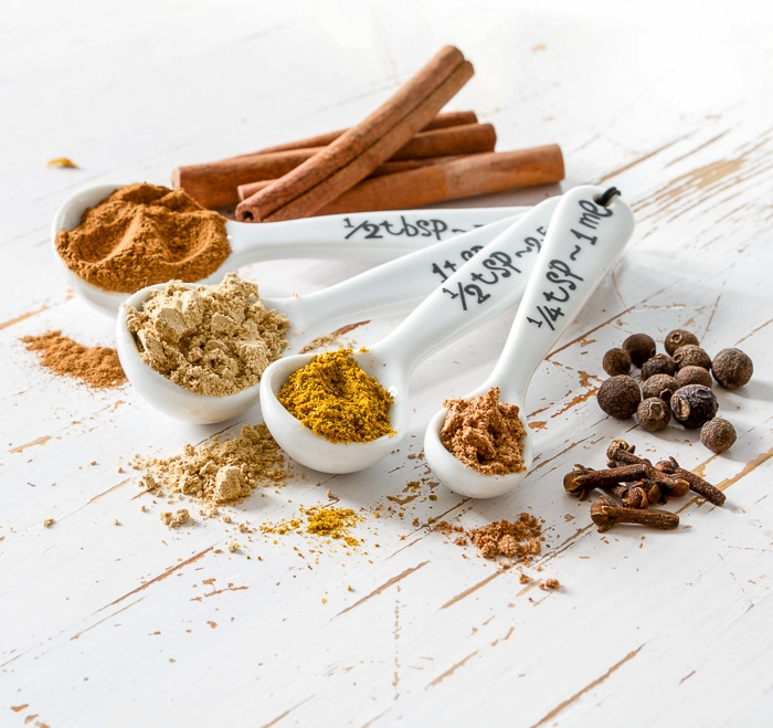 Stock Photo of Selection of spices for christmas and thanksgiving, white wood background, copy space