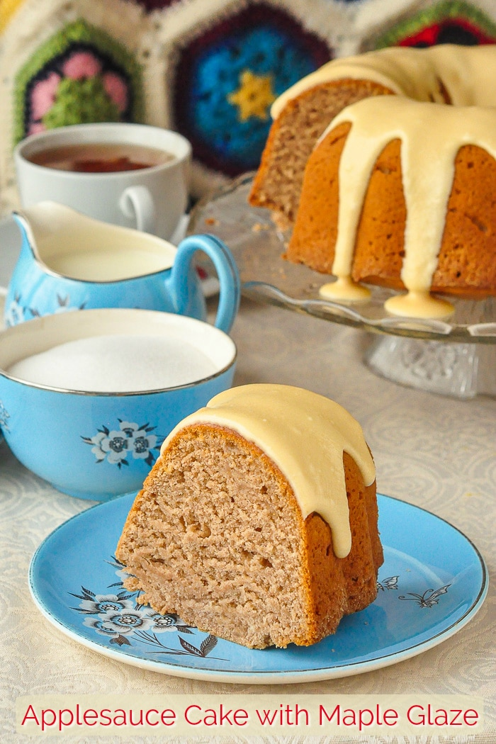 Applesauce cake photo of one slice with a blue tea service in background with title text added for Pinterest
