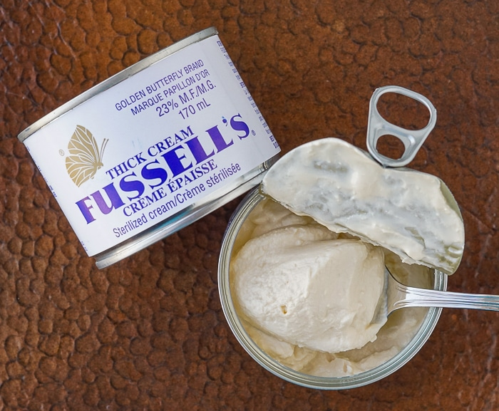 Can of Fussell's Cream opened with spoon inside