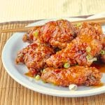 General Tso Chicken Wings close up photo of wings on white plate