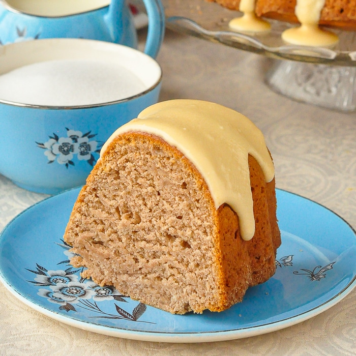 Photo of a single slice of applesauce cake on an antique blue floral tea service