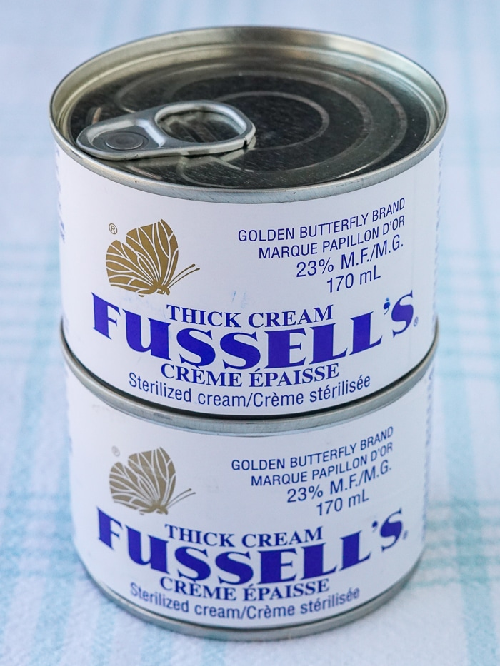 Two cans of Fussell's Cream stacked
