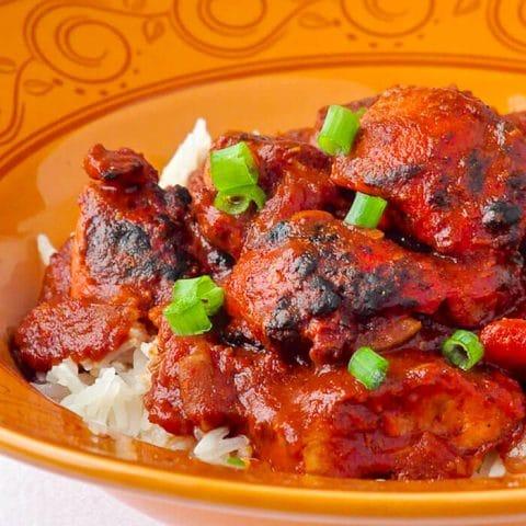 Chicken Tikka Masala image served over streamed rice.