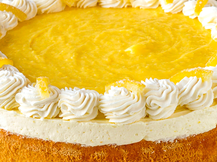 Lemon Mousse Cake close up photo of the top of the uncut cake