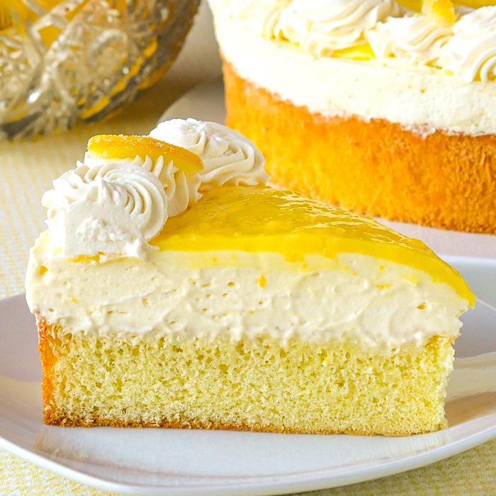 Lemon Mousse Cake photo of a single slice on a white plate