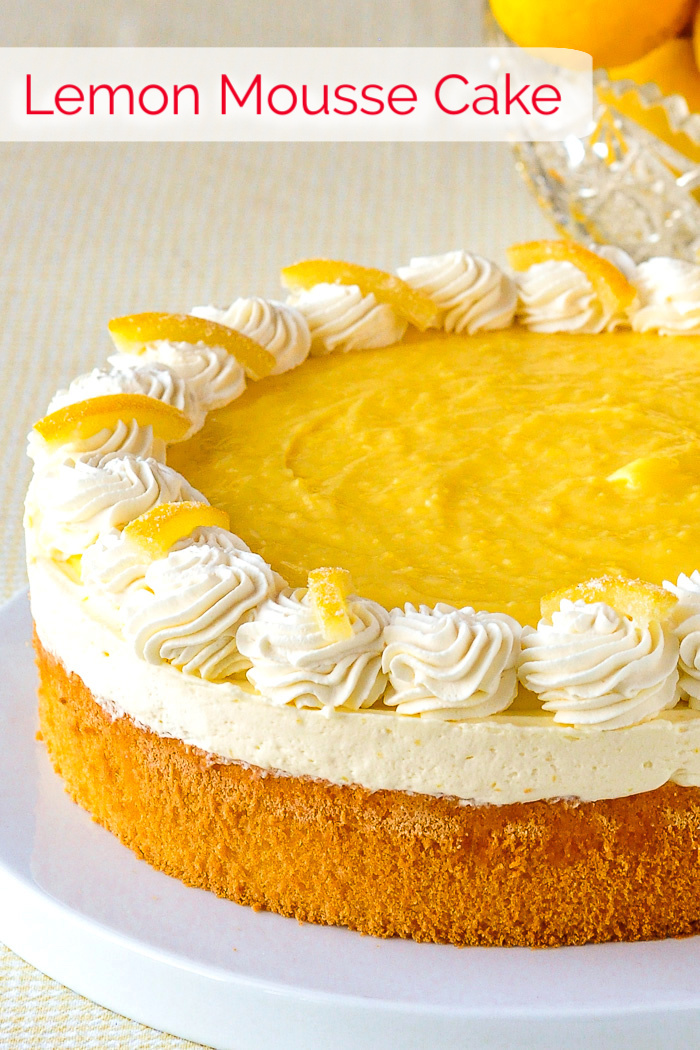 Lemon Mousse Cake photo of uncut cake with title text added for Pinterest