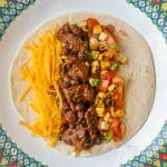 Beef Tacos From the Slow Cooker close up of single serving with grilled corn salsa