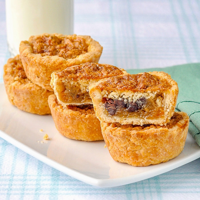 Loaded Butter Tarts with glass of milk in background