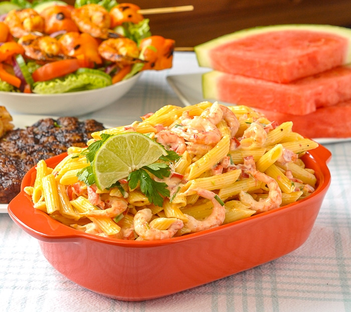 Penne Pasta Salad in an orange serving dish