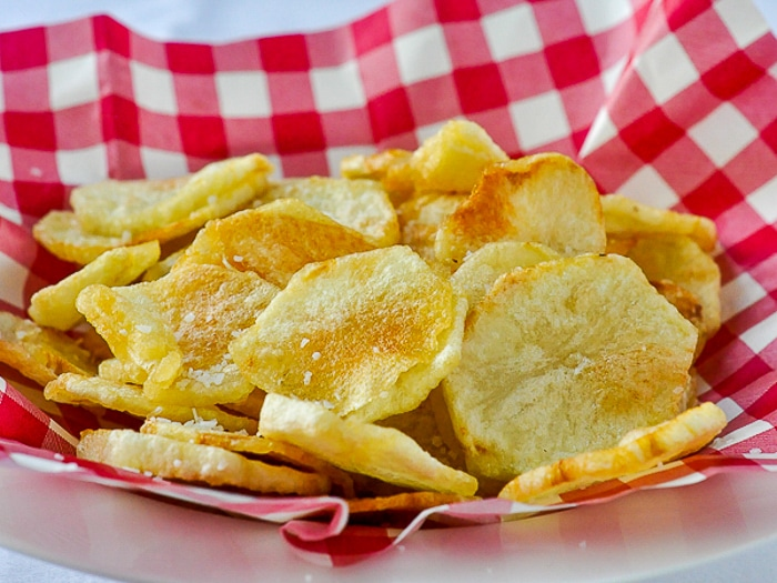 Fresh made kettle chips in a plastic serving baske