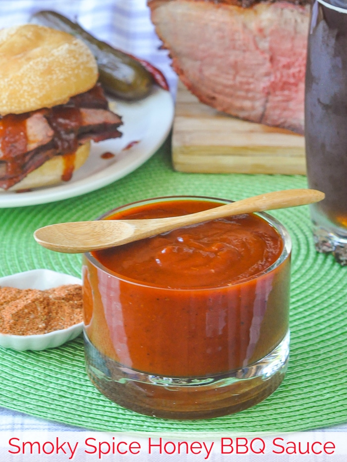 Smoky Spice Honey Barbecue Sauce in a clear glass serving dish with title text added for Pinterest
