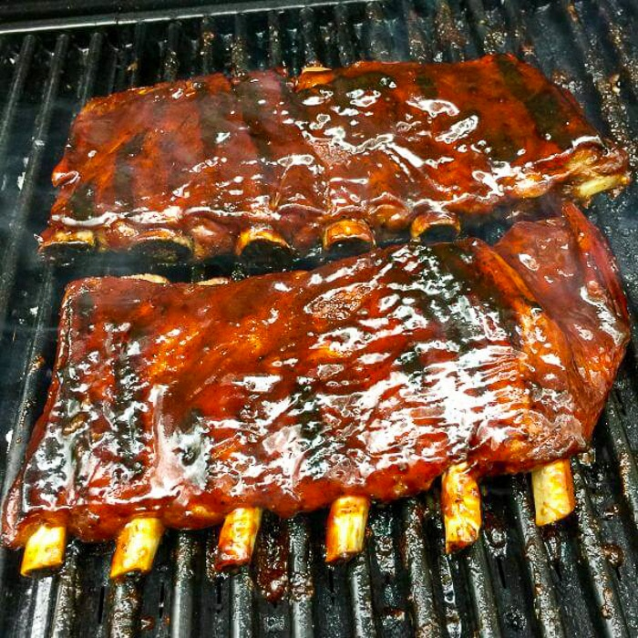 Smoky Spice Honey Barbecue Sauce on ribs being grilled