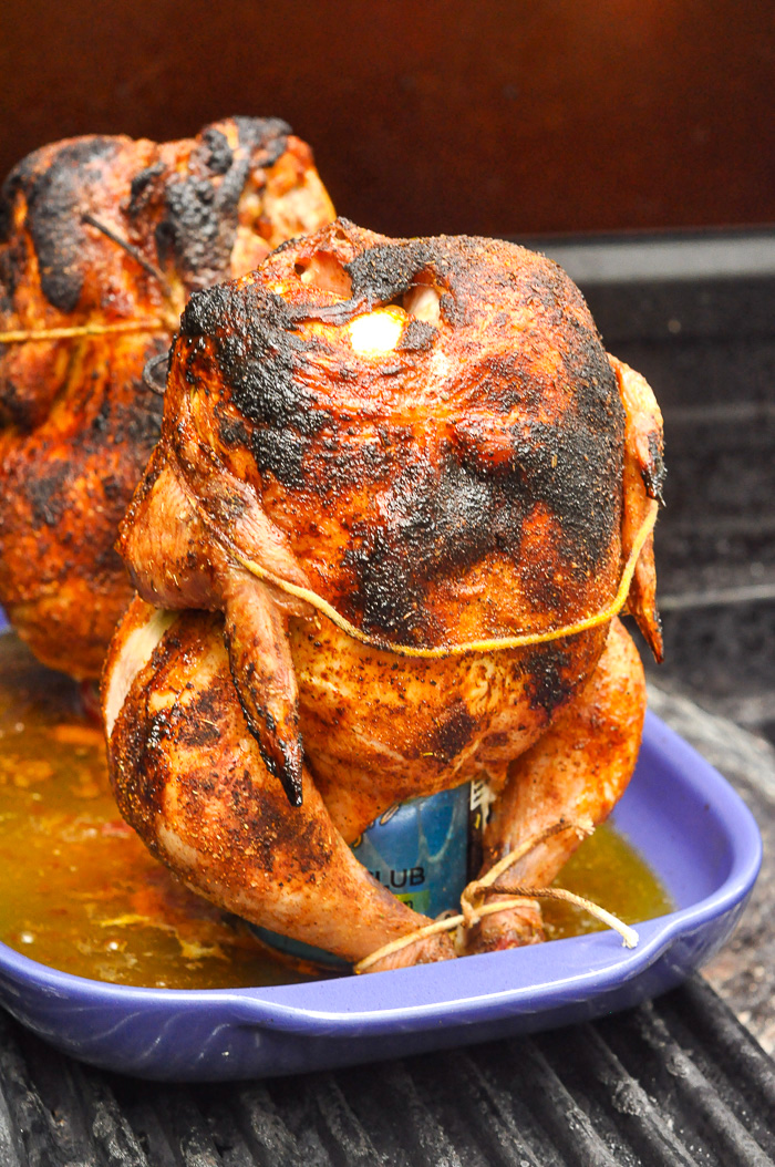 Beer Butt Chicken pictured fully cooked on a gas BBQ