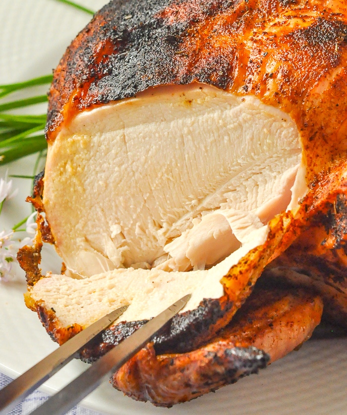 Close up photo of carving a Beer Butt Chicken