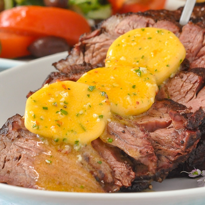 BBQ Prime Rib with Garlic Chili Butter close up photo of melting chili butter