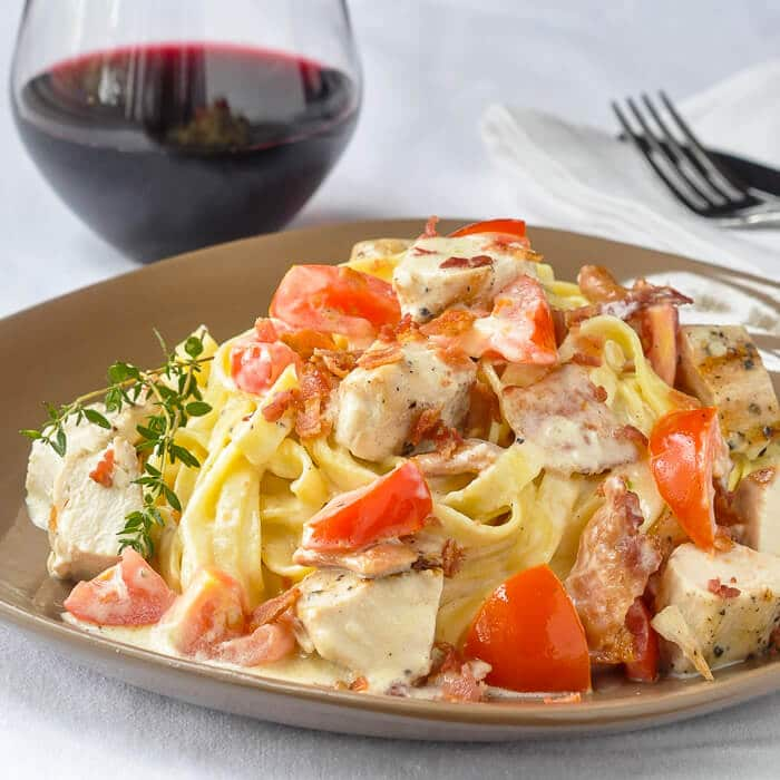 Fettuccine Alfredo with grilled chicken bacon and tomato