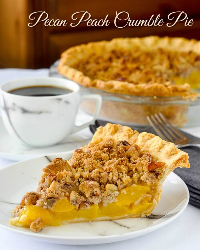 Pecan Peach Crumble Pie. A simple fresh peach filling in an all butter flakey crust, crowned with a buttery pecan & cinnamon crumble topping.