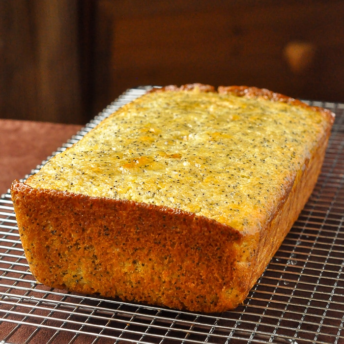 Lemon Poppy Seed Loaf Cake cooling on a wire rack