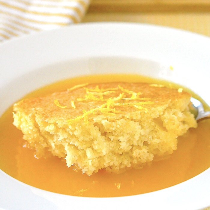 One serving of Lemon Pudding Cake in a white bowl