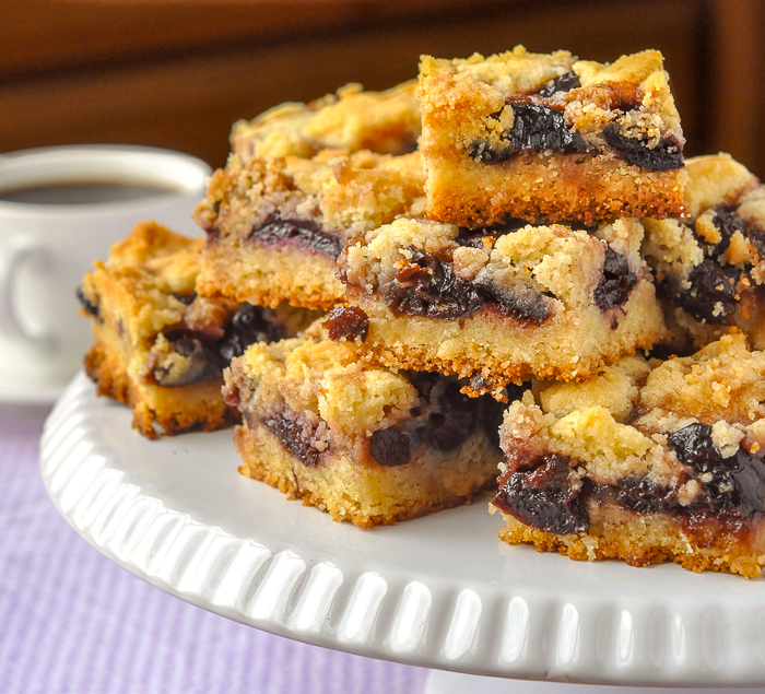 Cherry Almond Squares close up photo of stacked cookies