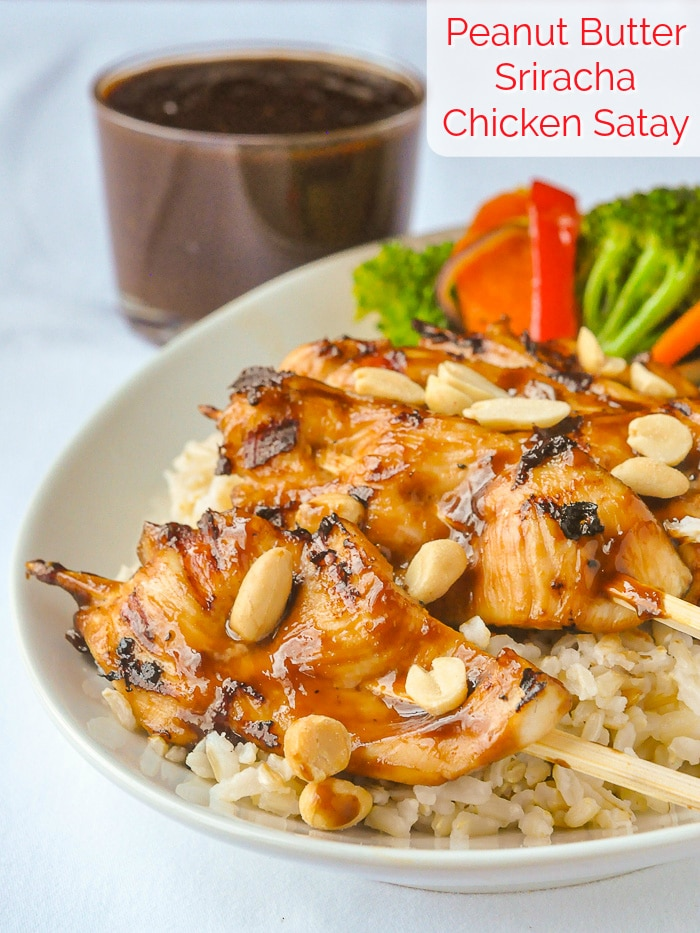 Peanut Butter Sriracha Chicken Satay photo shown on bed of rice with title text added for Pinterest