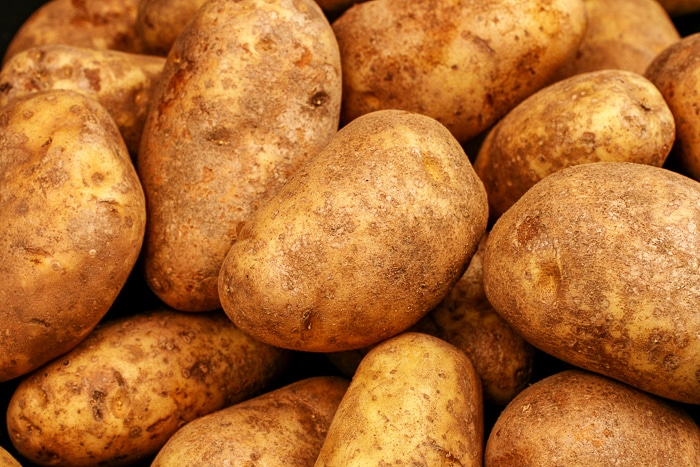 russet potatoes, close up image. Stock photo from Dwepositphotos