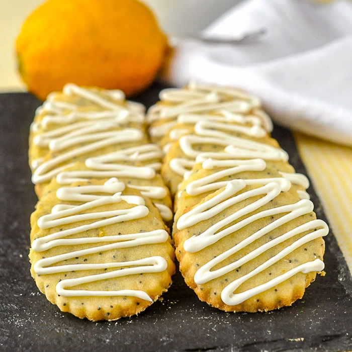 Lemon Poppy Seed Shortbread Cookies shown on serving platter